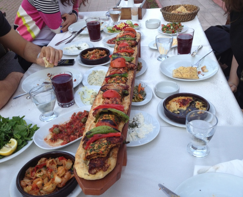 Şalgam served with a meter long Adana kebab