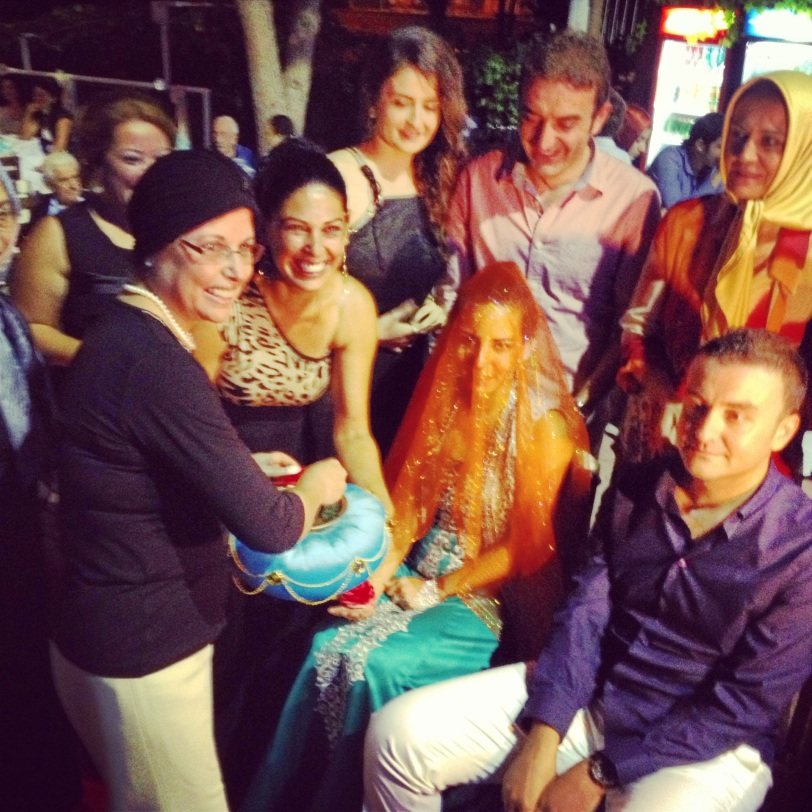 Their families gathered around the couple during the henna ceremony