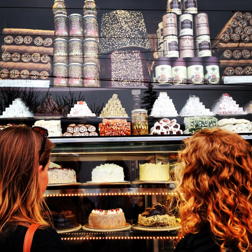 Gals gazing at a sweet shop