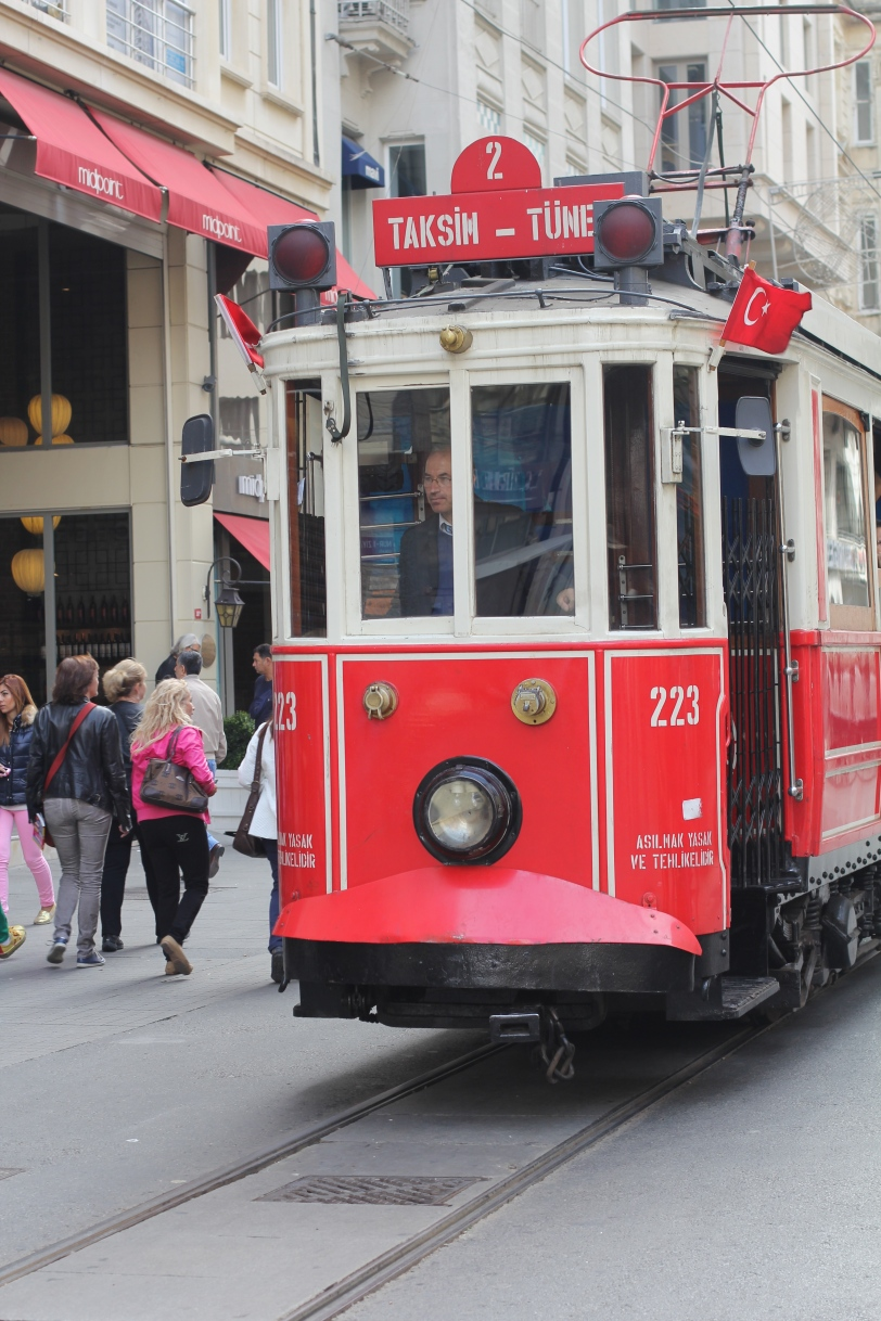 A street car runs up and down Istiklal Street